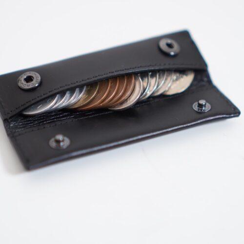 小さい小銭入れに999円入れる